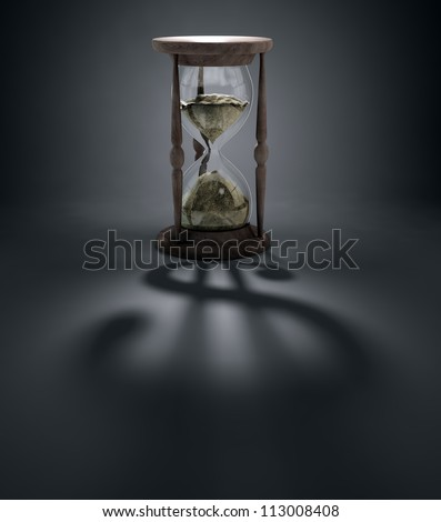 An hourglass casting a shadow of a dollar sign - time is money concept