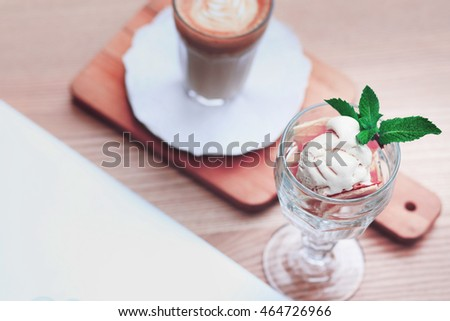 An ice cream and a latte. Cafe