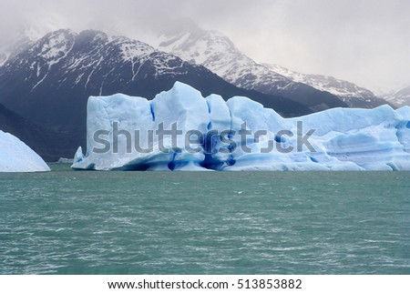 an iceberg floating in argentino lake, with a curious shape