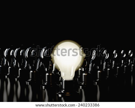 An illuminated fluorescent light bulb connected to an electrical cable  - stock photo