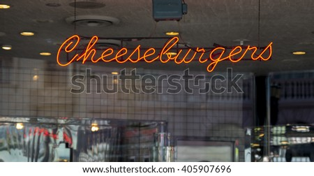 An illuminated neon Cheeseburger sign - stock photo