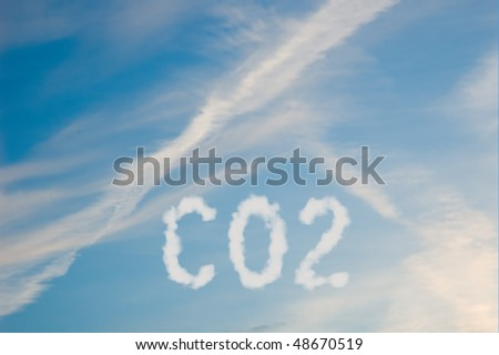 An illustration of the text CO2 made up of white puffy clouds to represent environmental issues or carbon footprint. - stock photo