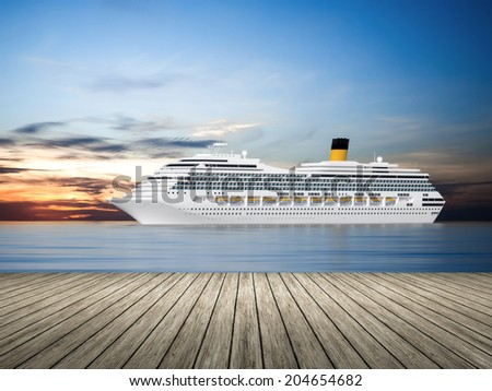 An image of a beautiful cruise ship in the sunset sky - stock photo