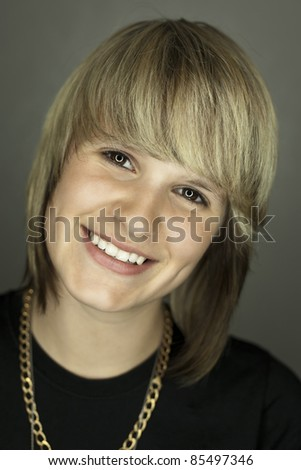 An image of a beautiful smiling teen girl - stock photo
