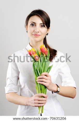 An image of a beautiful woman with tulips - stock photo