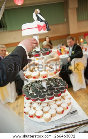an image of a bride and a groom is cutting their wedding cake - stock photo