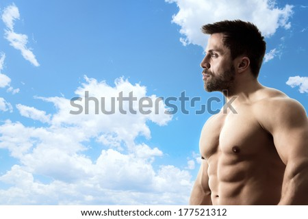 An image of a bright blue sky with a strong man - stock photo