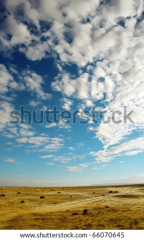 An image of a bright cloudy sky desert background - stock photo