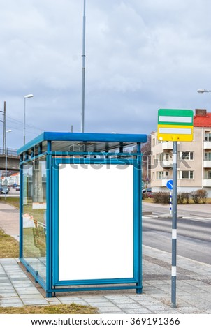 An image of a bus stop with a blank bilboard for your advertising situated in the swedish town of Helsingborg. - stock photo
