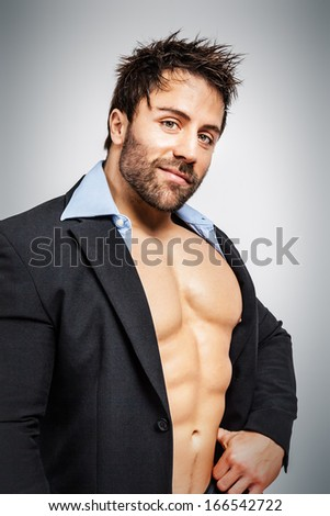 An image of a business man with muscles - stock photo