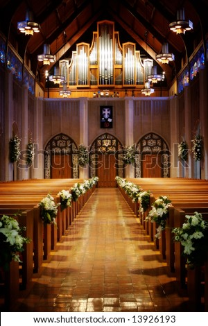 An image of a church sanctuary before a wedding ceremony - stock photo