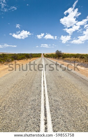 An image of a desert road in Australia - stock photo