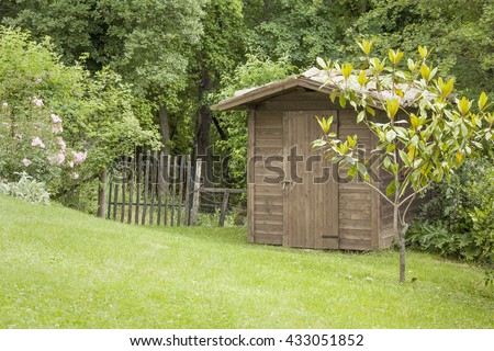 An image of a garden hut and an old gate - stock photo