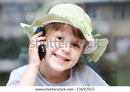 An image of a girl speaking on the phone