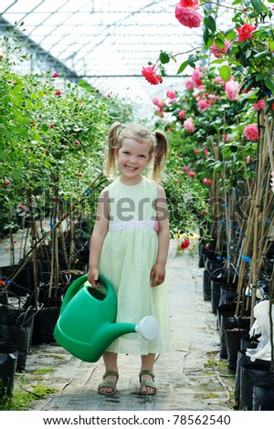 An image of a girl with a watering can - stock photo