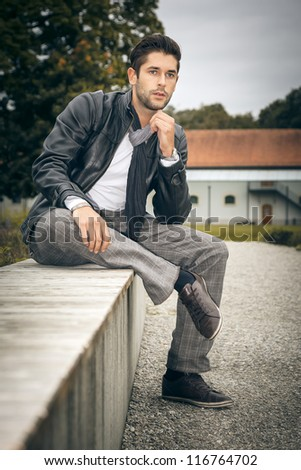 An image of a handsome man outdoor - stock photo