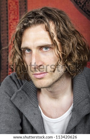 An image of a handsome man with a curly hairdo - stock photo