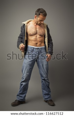 An image of a handsome muscle man - stock photo
