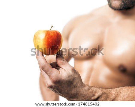 An image of a handsome young muscular sports man and a apple