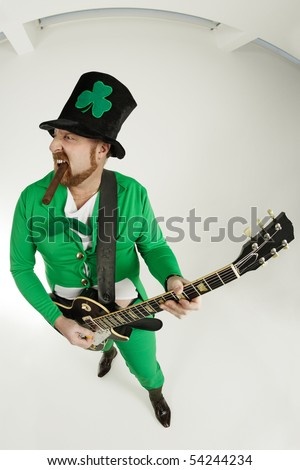 An image of a Leprechaun playing electric guitar. - stock photo