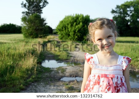 An image of a little girl outdoors - stock photo