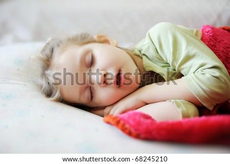 An image of a little girl sleeping - stock photo
