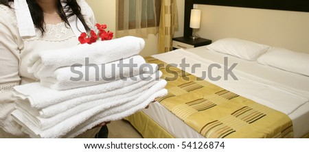an image of a maid in hotel room - stock photo