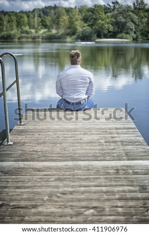An image of a man at the lake