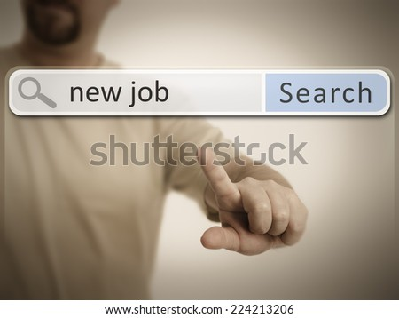 An image of a man who is searching the web after a new job - stock photo
