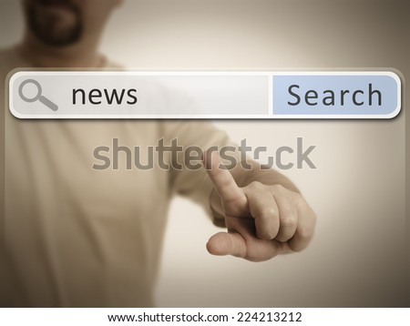 An image of a man who is searching the web after news - stock photo