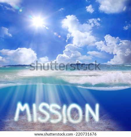 An image of a nice blue compass with the word MISSION by beam shines through the seafloor ocean. Tropical Caribbean sunrays with beautiful lenses flare and cloudy on blue sky design template.  - stock photo