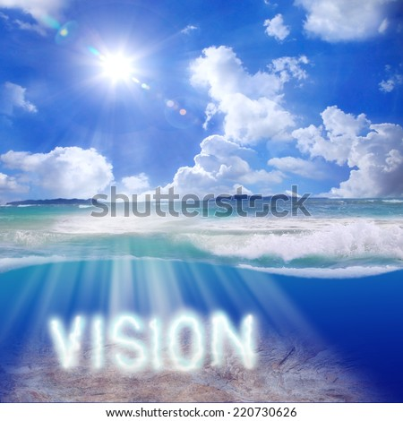 An image of a nice blue compass with the word Vision by Beam shines through the seafloor ocean. Tropical Caribbean sunrays with beautiful lenses flare and cloudy on blue sky design template.  - stock photo