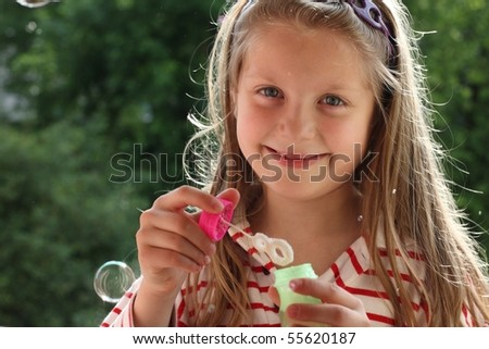 An image of a nice girl making bubbles