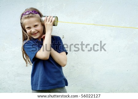 An image of a nice little girl with a toy-telephone
