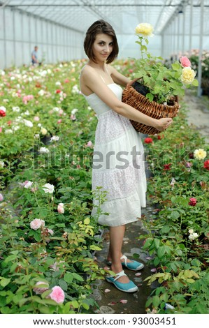 An image of a nice young girl in a greenhouse - stock photo
