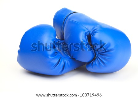 An image of a pair of blue boxing gloves - stock photo