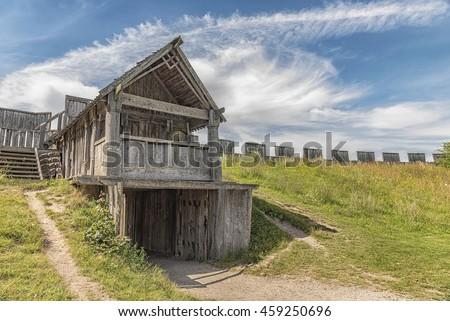 An image of a reconstructed wooden viking fort called a trelleborg in the swedish city of the same name.