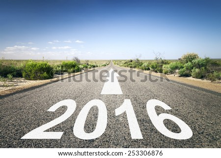 An image of a road to the horizon with number 2016 - stock photo