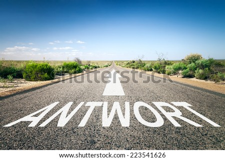 An image of a road to the horizon with text answer in german language - stock photo