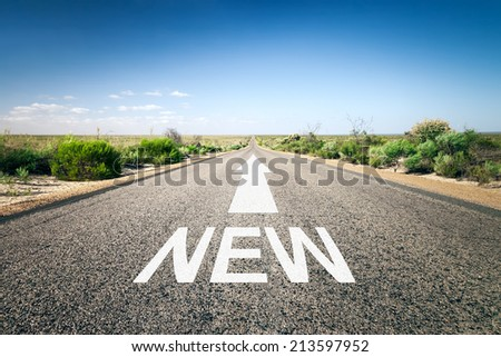 An image of a road to the horizon with text new - stock photo