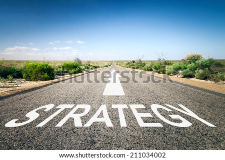 An image of a road to the horizon with text strategy - stock photo