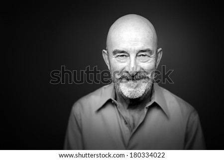 An image of a senior man with a beard