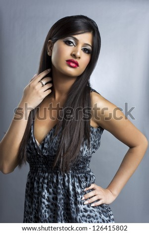 An image of a sensual model with her left hand on her hips - stock photo