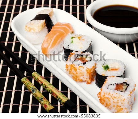 An image of a set of sushi and soy