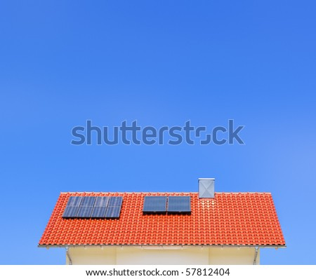 An image of a solar panel on the roof - stock photo