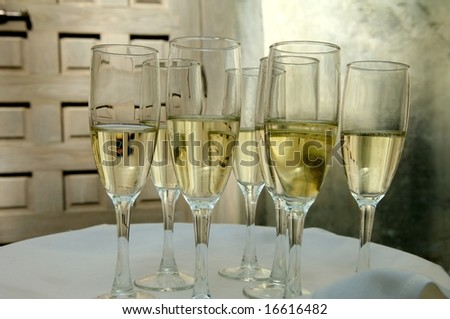 An image of a tray full of champagne in flutes