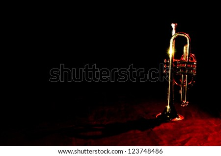 An image of a trumpet on black - stock photo