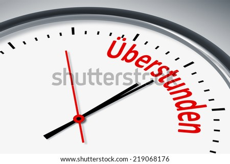 An image of a typical clock with text overtime in german language