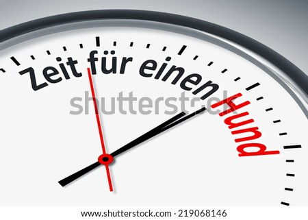 An image of a typical clock with text time for a dog in german language