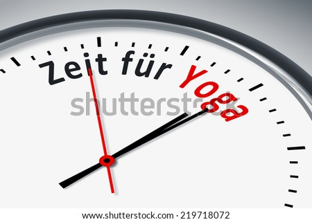 An image of a typical clock with text time for yoga in german language